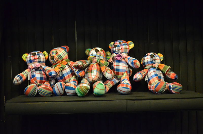 Close-up of colorful teddy bears on table