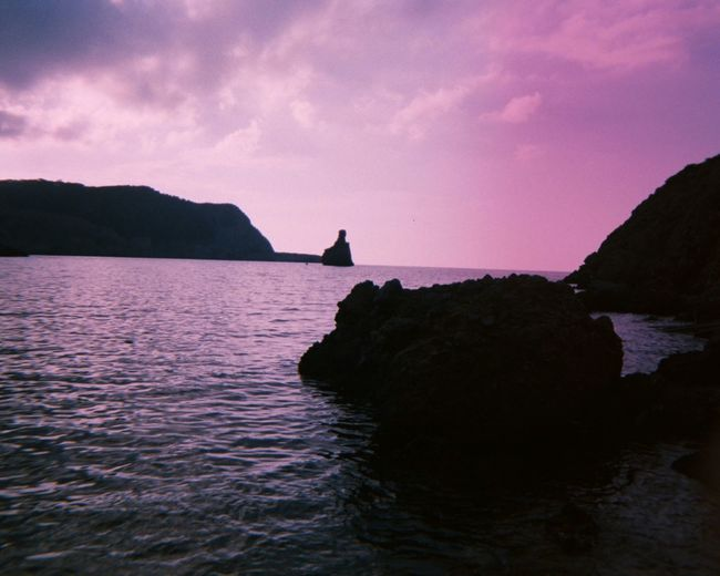 Ibiza Sunset Beauty In Nature No People Sunset_collection Rock Formation Sea And Sky Imperfectly Perfect Analogue Photography Unedited Film Photography Nature_collection Light And Shadow Ibiza Water_collection Silhouette_collection Purple Hue Travel Destinations Disposablecamera Seaside Ibiza Beach Finding New Frontiers Millennial Pink The Secret Spaces Live For The Story Breathing Space Been There. Lost In The Landscape Perspectives On Nature