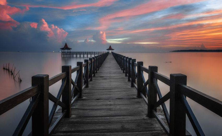 Before Daylight at The Probolinggo EyeEm Selects Sky Water Railing Beauty In Nature Scenics - Nature Cloud - Sky Nature Sea Sunset Pier Wood - Material Architecture Tranquility Tranquil Scene Bridge Horizon Built Structure The Way Forward Direction Horizon Over Water