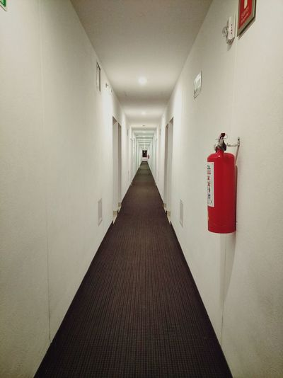 Hotel Architecture Corridor Arcade Indoors  Building Diminishing Perspective Direction Built Structure No People Emergency Equipment Safety Security Flooring