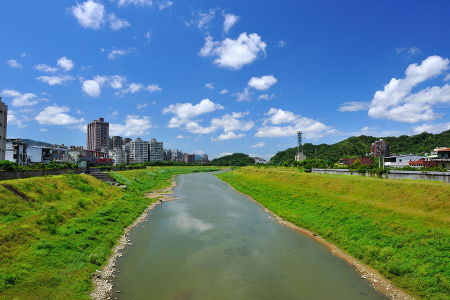 River beautiful landscape, fresh natural environment, the city leisure place Keelung River Natural Scenes Taiwan Architecture Beauty In Nature Building Exterior Built Structure City Cityscape Cloud - Sky Day Grass Nature New Taipei City No People Outdoors River Scenics Sky Travel Destinations Tree Water Waterfront Xizhi