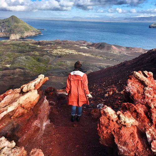 Rear View Full Length Of Woman At Vestmannaeyjar Looking At Sea