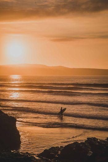 Sunset Water Sky Sea Scenics - Nature Beauty In Nature A New Beginning Orange Color Land Beach Tranquility Idyllic Tranquil Scene Nature Reflection Sunlight Horizon Over Water Horizon Non-urban Scene Silhouette Outdoors