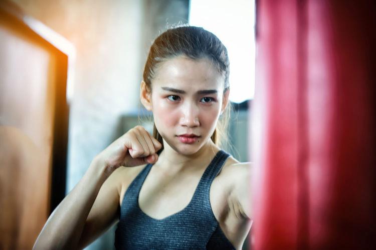 Female boxer punching bag