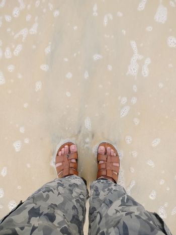 Beach time. Water Foam Army Style Camouflage Clothing Sand Sandy Beach Holidays Vacation Travel Travel And Leisure Leisure India Low Section Men Human Leg Relaxation Standing Motion Enjoyment Water Human Foot Footwear Feet Personal Perspective Flip-flop Pair Slipper  Shore Human Toe Flat Shoe
