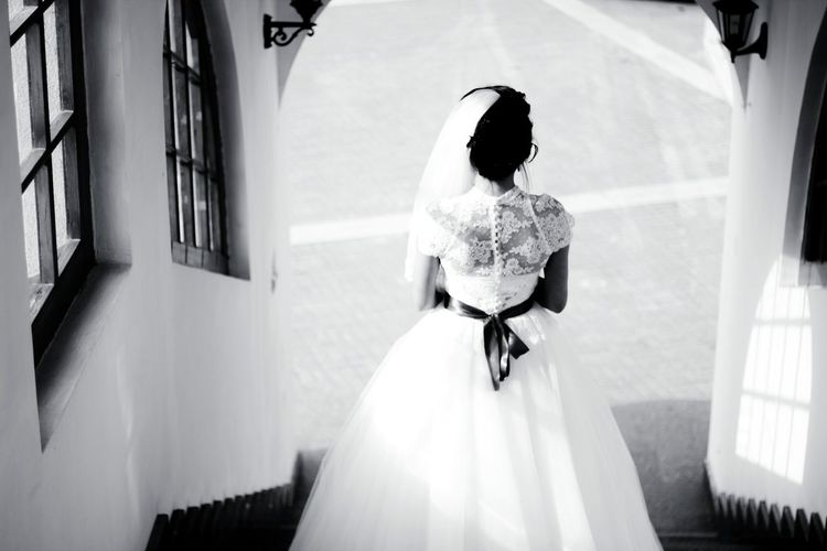 Rear view of bride moving down on steps