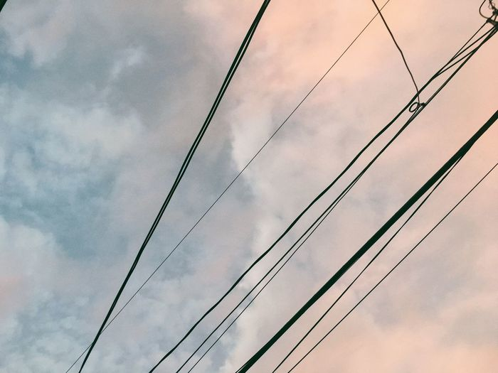 Low Angle View Cable Connection Power Line  Sky Cloud Cloud - Sky Day Power Supply Nature Power Cable Beauty In Nature Tranquility Cloudy Outdoors Scenics Cloudscape Steel Cable No People Majestic