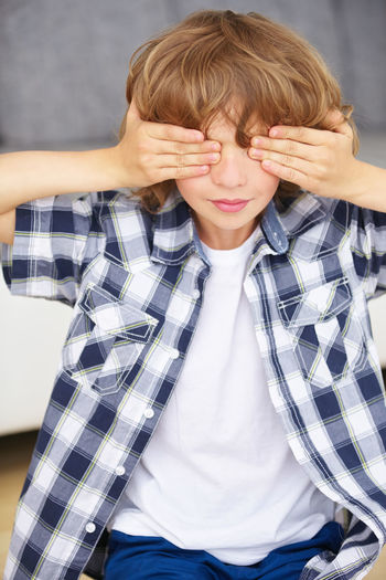 Close-Up Of Boy Covering Eyes