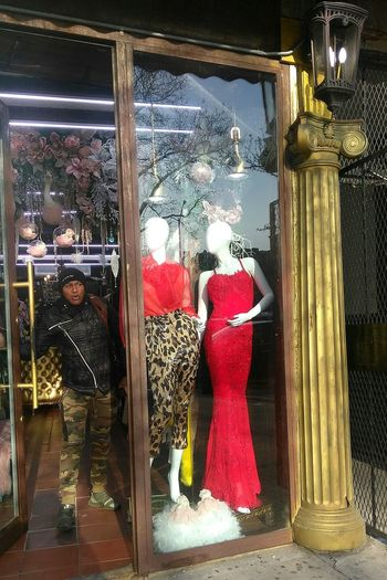 camouflaged. photo by Shell Sheddy Camouflage Camouflage Clothing Shellsheddyphotography Sheshephoto Streetphotography Street Photo Journalism Documentary Photography Red Store Retail  Window Store Window Consumerism Window Shopping Window Display Mannequin Display Streetwise Photography