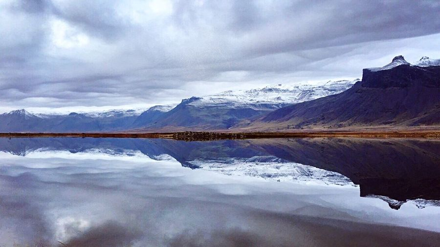 Love the way still water creates these refelexions. This was taken on the way to Snaefellsjoekull National Park in Iceland . Reflection Lake Water Tranquility Beauty In Nature Mountain Nature Sky Scenics Snow Landscape Tranquil Scene Outdoors No People Mountain Range Day Winter Cold Temperature Lake View Eye4photography  Miles Away