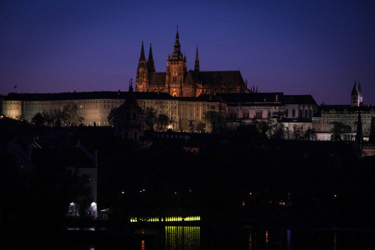 Prague Castle At Night, Illuminated Building Exterior Architecture Built Structure Night Sky Illuminated Building City No People Travel Destinations Nature Religion History The Past Clear Sky Place Of Worship Spirituality Travel Dusk Outdoors Spire  Castle Prague Castle (Pražský Hrad) Lights Travel Location Turism Photography Prague Czech Republic Visiting Places To Visit In Jaipur