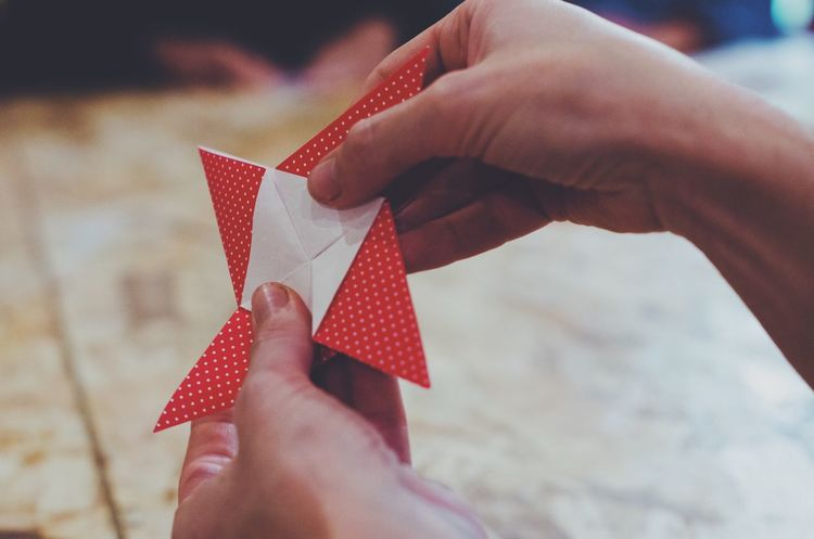 folding origami Human Hand Origami Folding Paper Red Close-up Hands Work Creativity Creative Workshop Creation Woman Indoors  Day Real People Holding Activity Japanese  Table