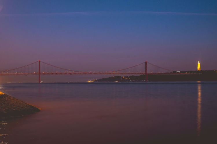 Lisbon bridge in the evening Architecture Built Structure Travel Destinations Lisbon Portugal Europe Bridge Water Bridge - Man Made Structure Sky Suspension Bridge Connection Engineering Transportation Bay Nature Tourism Bay Of Water River Travel Waterfront Outdoors