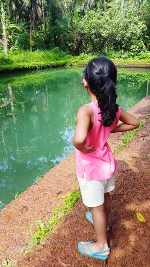 Childhood Rear View Girls Water Full Length Children Only Child Day One Person Standing Pink Color One Girl Only Outdoors People Tree Adult