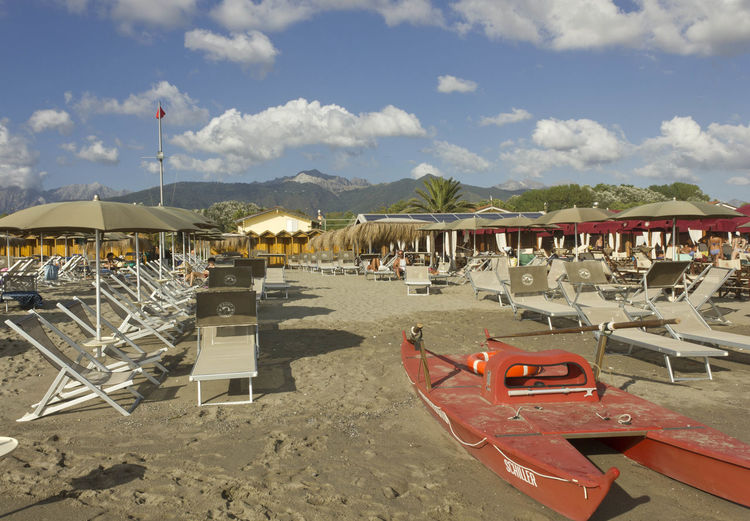 Bathing establishment in Marina di Massa Alps Italy Forte Dei Marmi Lifeboat Marina Di Massa Rowboat Tuscany Alps Bathing Establishment Beach Beach Day Beach Umbrella Day Italy Land Lifesaver Lounge Chair Outdoors Parasol Sand Shore Summer Sun Umbrella Versilia
