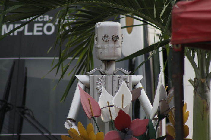 "Robot-liked statues are placed around Ricaurte in Colombia. Each one has a purpuse. Either remind of recicling, hold nets for garbage, etc. They are made of reused metal. This is an example of creating concious about climate change. Even decoration may be a good way of reusing ""wastes"" Conciousness  Example How Do We Build The World? How Do You See Climate Change? Me Natural Light Reused Robot The Week Of Eyeem On The Way"