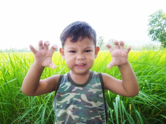 Cute asian boy with rice paddy background Asian  Thailand Agriculture Boy Cute Young Childhood Field Farm Rice Paddy Background Nature Fresh Portrait Child Smiling Childhood Happiness Looking At Camera Cheerful Cute Front View Sky Farmland