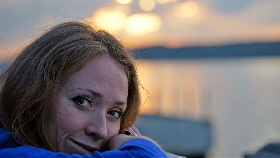 Close-up portrait of woman during sunset