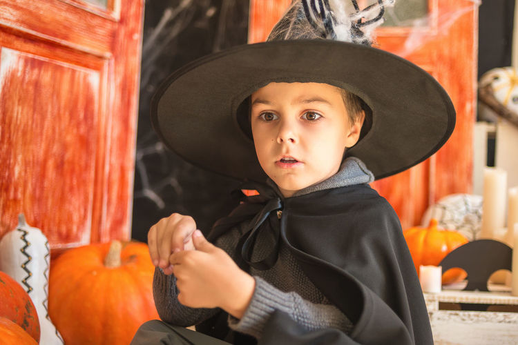 Boy Wearing Witch Costume At Home