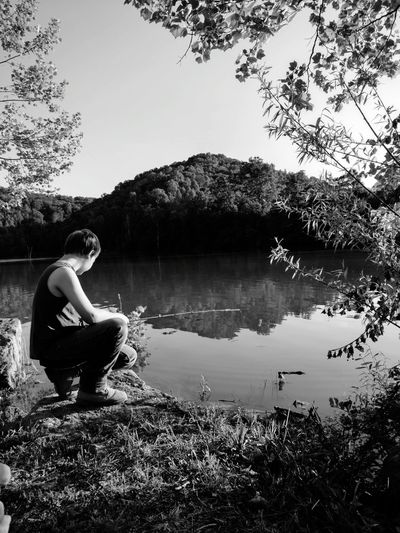 Lake One Person Tree Nature Water Weekend Activities Leisure Activity Outdoors Scenics Tranquil Scene Beauty In Nature Tranquility Tree Young Boy Fishing EyeEmNewHere The Great Outdoors - 2017 EyeEm Awards