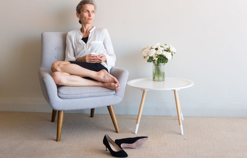 Woman sitting on chair at home