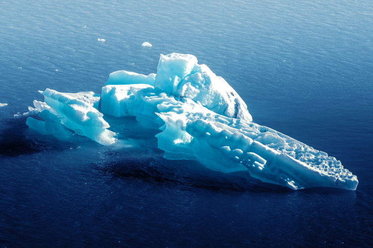 Aerial view of iceberg floating on sea