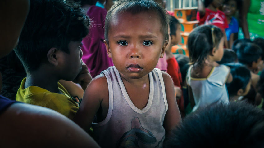 Charity Childhood Donate Elementary Age Filipino Front View Help Help People Innocence Need Help Person Philippines Poor Kids Poorpeople Portrait Real People Save The World Third World Third World Country