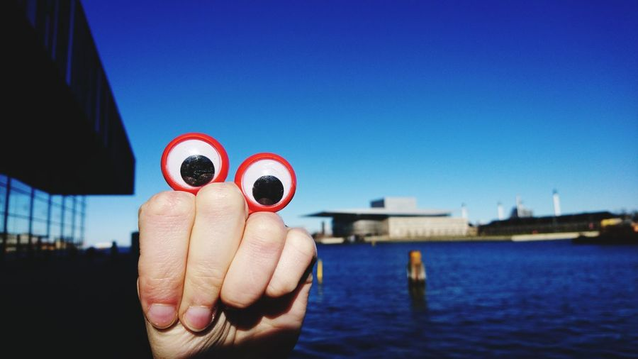 Close-Up Of Googly Eyes On Hand