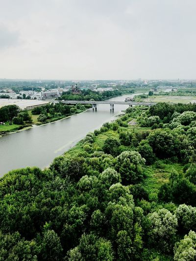 High angle view of plants and river against sky
