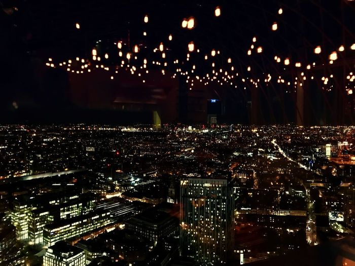 There is so much beauty when your eyes lay lost in the all city lights - motionless in white Illuminated Night Cityscape City Building Exterior Architecture Skyscraper Nightlife Sky Modern Built Structure First Eyeem Photo The Graphic City