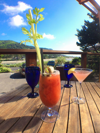 Outdoor dining and refreshments over looking the bay at Yachats, Oregon. Alcohol Bloody Mary Blue Cloud - Sky Cosmopolitan Drink Drinking Glass Food And Drink Freshness Oregon Coast Outdoors Refreshment Sky Still Life Sunlight Table Wood Yachats