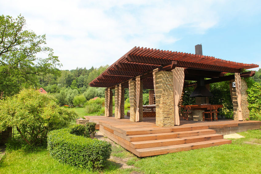 Garden brick house with wooden couch and white pillows Architecture Beauty In Nature Brick Built Structure Cloud - Sky Day Forest Furniture Garden Gardening Gazebo House Nature No People Outdoors Roof Sky Tree Wood - Material