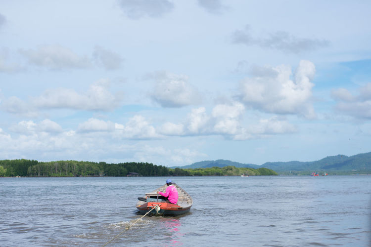 Fisherman fishing in river