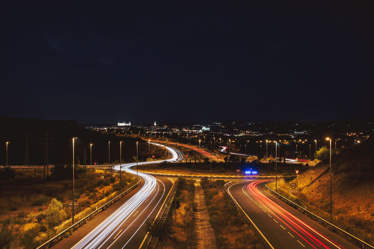 Car light trails in the city of toledo. creative night photography