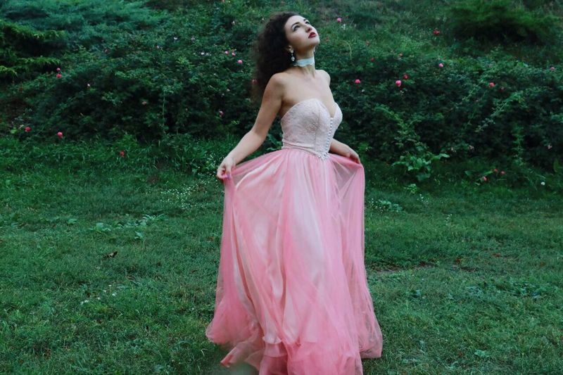 Dress Grass Young Adult Field One Person Pink Color Green Color Outdoors Young Women Beautiful Woman Evening Gown One Young Woman Only Standing Fashion Model Day Adult Beauty Full Length Only Women