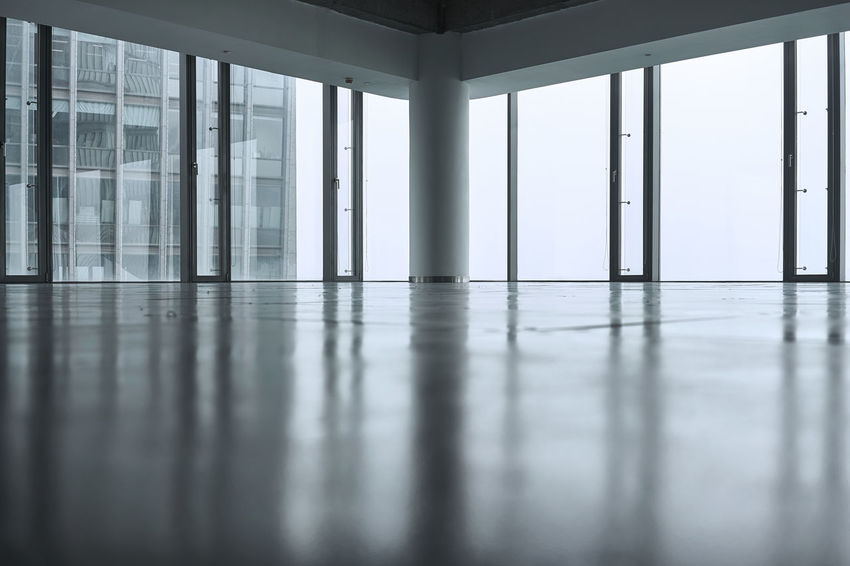 Empty office space in a new office block in China Architectural Column Architecture Built Structure Day Empty Floor Focus On Foreground Indoors  No People Office Reflection Reflection Spaces Window