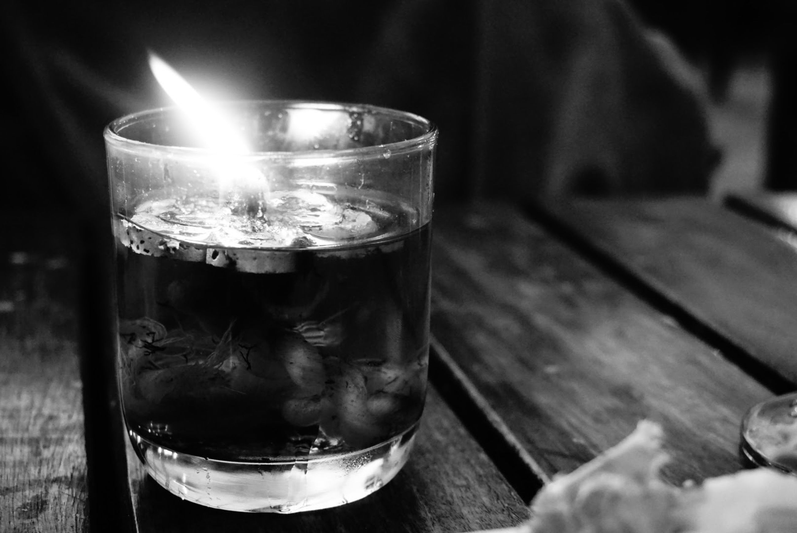refreshment, candle, close-up, alcohol, focus on foreground, still life, illuminated, heat - temperature, glowing, no people, lit, selective focus, dark