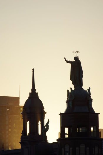 Low angle view of statue at sunset