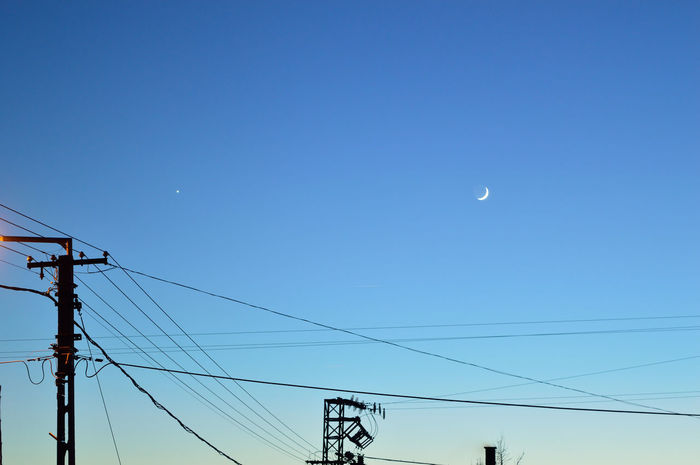 Moon and Venus Venus Astronomy Blue Cable Clear Sky Connection Crescent Electricity  Half Moon Low Angle View Moon No People Power Line  Sky