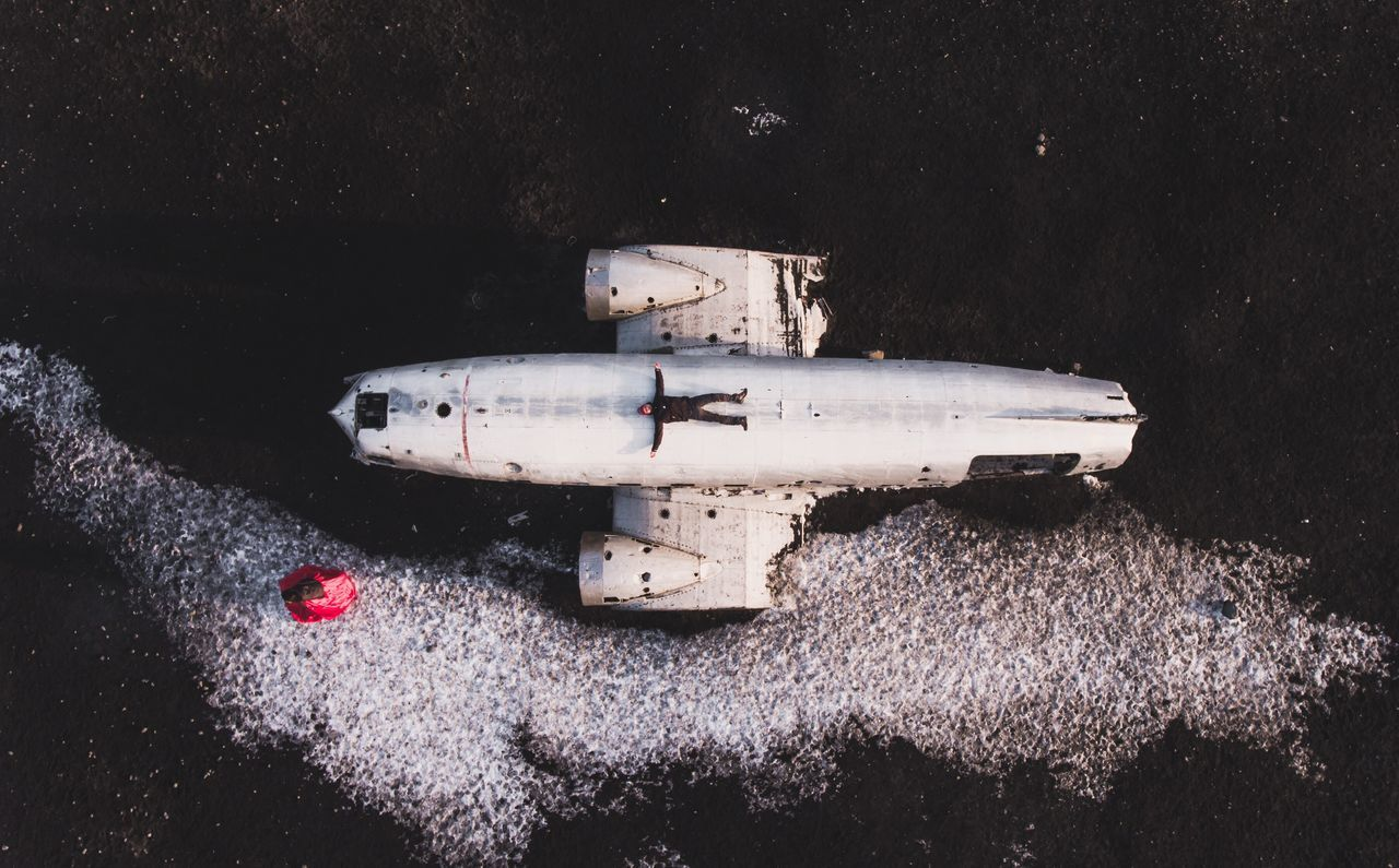 Man lying on abandoned plane