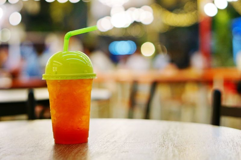 Cup of iced tea on bokeh background Bokeh Thailand Bangkok Prathunam Lemon Tea Iced Tea Drink Focus On Foreground Food And Drink Table Bottle Indoors  Close-up Refreshment No People Freshness Drinking Glass
