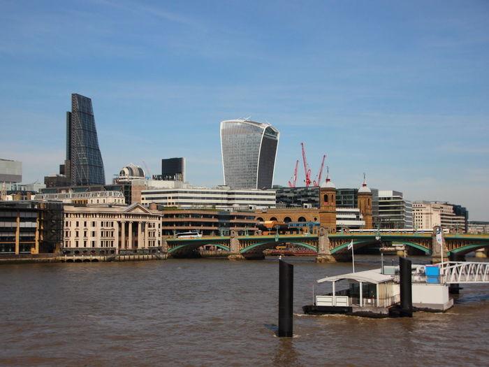 Southwark bridge over thames river against sky