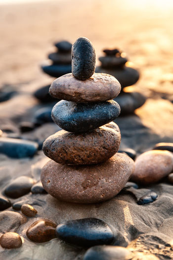 Stack of pebbles on sand