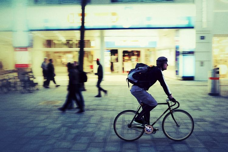 Bike rider in Vienna Bicycle Motion Speed Cycling Mode Of Transport City On The Move Blurred Motion Activity City Life Riding Only Men Transportation People Real People Photo Outdoors EyeEm New Here Brunomphotography Photography Street Vienna