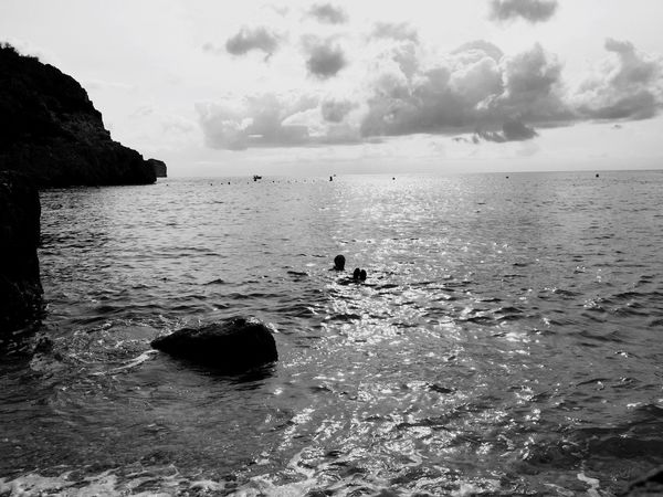 Sea Water Horizon Over Water Scenics Tranquil Scene Beach Leisure Activity Beauty In Nature Tranquility Lifestyles Rock - Object Sky Nature Cloud - Sky Shore Vacations Remote Waterfront Outdoors Day Floating On Water Swimming Bathing Lagoon Sandies Seascape