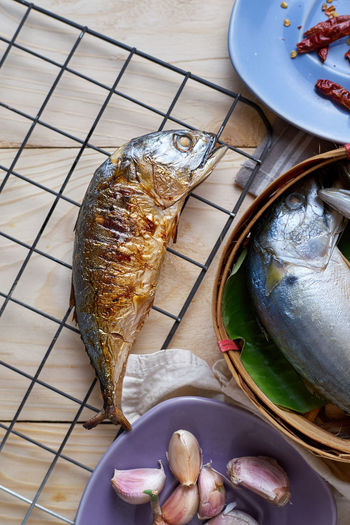Close-up Day Fish Food Food And Drink Freshness Grill Grille Healthy Eating High Angle View Lunch No People Salmon - Seafood Seafood Short Mackerel Table Thai Food Wooden