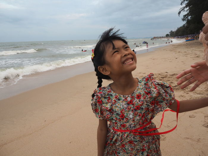 Portrait of happy girl on beach