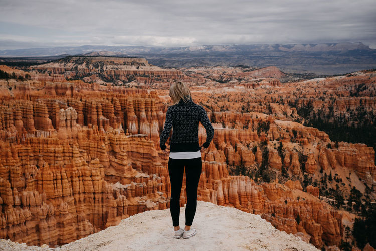 Bryce Canyon Bryce Canyon National Park Bryce Canyon National Park, Utah Utah Scenery Us National Park Rear View One Person Full Length Real People Leisure Activity Sky Lifestyles Rock Standing Beauty In Nature Rock - Object Scenics - Nature Adult Mountain Casual Clothing Non-urban Scene Nature Solid Women Cloud - Sky Looking At View Outdoors