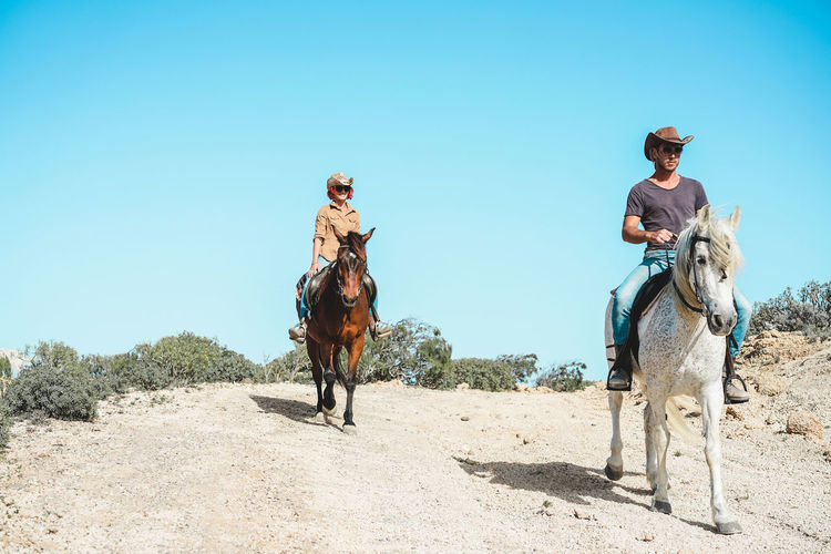 Horse Working Animal Land Animal Wildlife Nature Real People Riding Day Outdoors People Couple