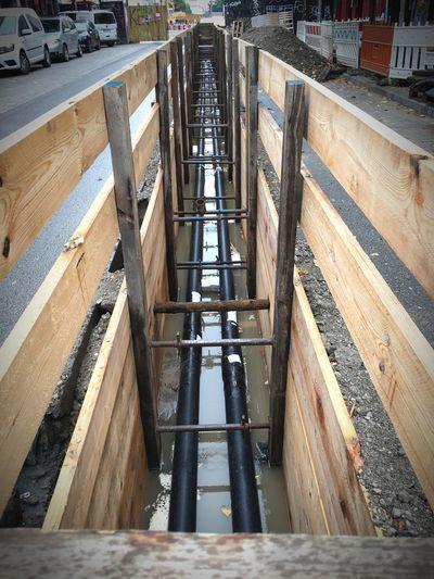 Es regnet in die Straße rein Berlin Open Street Construction Site Rigaer No People Day Wood - Material Outdoors Water